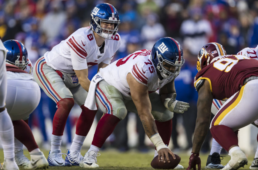 LANDOVER, MD - DECEMBER 22: Daniel Jones #8 of the New York Giants awaits the snap of the ball from Jon Halapio #75 during overtime of the game against the Washington Redskins at FedExField on December 22, 2019 in Landover, Maryland. (Photo by Scott Taetsch/Getty Images)