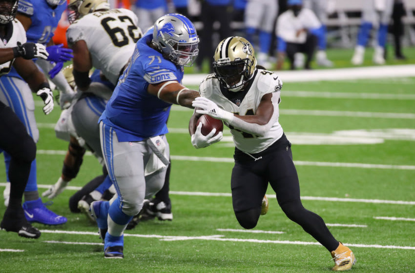 Alvin Kamara #41 of the New Orleans Saints tries to get past the tackle of Danny Shelton (Photo by Gregory Shamus/Getty Images)