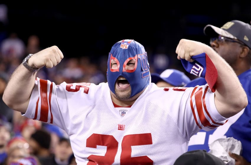 EAST RUTHERFORD, NJ - NOVEMBER 14: A New York Giants fan cheers during the first half of the game between the Cincinnati Bengals and the New York Giants at MetLife Stadium on November 14, 2016 in East Rutherford, New Jersey. (Photo by Al Bello/Getty Images)