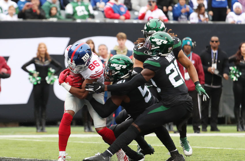 EAST RUTHERFORD, NEW JERSEY - NOVEMBER 10: Darius Slayton #86 of the New York Giants scores a first quarter touchdown against Brandon Copeland #51 and Nate Hairston #21 of the New York Jets during their game at MetLife Stadium on November 10, 2019 in East Rutherford, New Jersey. (Photo by Al Bello/Getty Images)