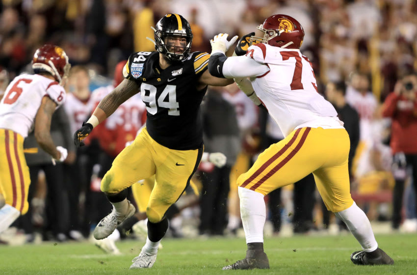 SAN DIEGO, CALIFORNIA - DECEMBER 27: Austin Jackson #73 of the USC Trojans blocks A.J. Epenesa #94 of the Iowa Hawkeyes during the second half of the San Diego County Credit Union Holiday Bowl at SDCCU Stadium on December 27, 2019 in San Diego, California. (Photo by Sean M. Haffey/Getty Images)