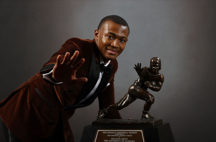 NEW YORK, NEW YORK - JANUARY 05: (EDITORIAL USE ONLY through Tuesday, January 12, 2021. Approval by the Heisman Trust will be needed for any usage thereafter or any Commercial usage requests at any point.) Wide receiver DeVonta Smith of the Alabama Crimson Tide poses with the Heisman Memorial Trophy on January 05, 2021 in New York, New York. (Photo by Kent Gidley/Heisman Trophy Trust via Getty Images)