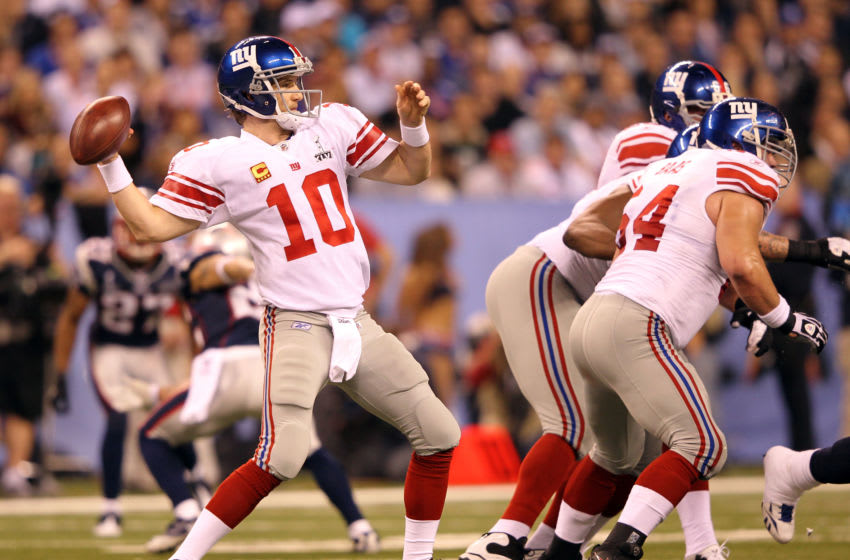 INDIANAPOLIS, IN - FEBRUARY 05: Eli Manning #10 of the New York Giants in action against the New England Patriots during Super Bowl XLVI at Lucas Oil Stadium on February 5, 2012 in Indianapolis, Indiana. (Photo by Jamie Squire/Getty Images)