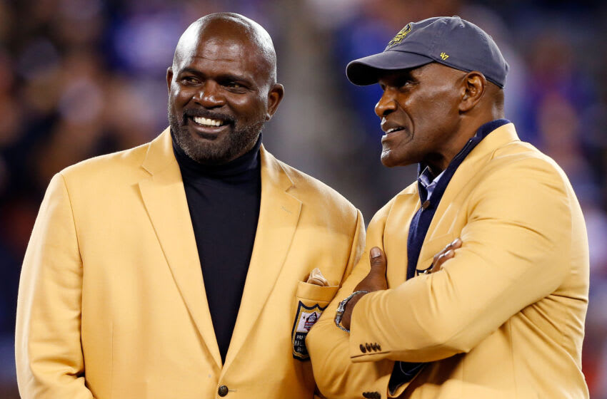 EAST RUTHERFORD, NJ - NOVEMBER 03: (NEW YORK DAILIES OUT) Hall of Famers Lawrence Taylor (L) and Harry Carson talk during a halftime ceremony of a game between the New York Giants and the Indianapolis Colts on November 3, 2014 at MetLife Stadium in East Rutherford, New Jersey. The Colts defeated the Giants 40-24. (Photo by Jim McIsaac/Getty Images)