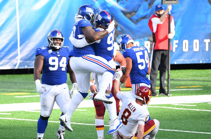 Oct 18, 2020; East Rutherford, New Jersey, USA; The New York Giants celebrate after breaking up a two-point conversion attempt by Washington Football Team quarterback Kyle Allen (8) in the fourth quarter at MetLife Stadium. Mandatory Credit: Robert Deutsch-USA TODAY Sports