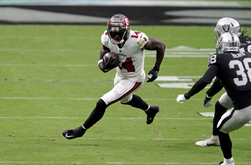 Oct 25, 2020; Paradise, Nevada, USA; Tampa Bay Buccaneers wide receiver Chris Godwin (14) carries the ball against the Las Vegas Raiders during the first half at Allegiant Stadium. Mandatory Credit: Kirby Lee-USA TODAY Sports