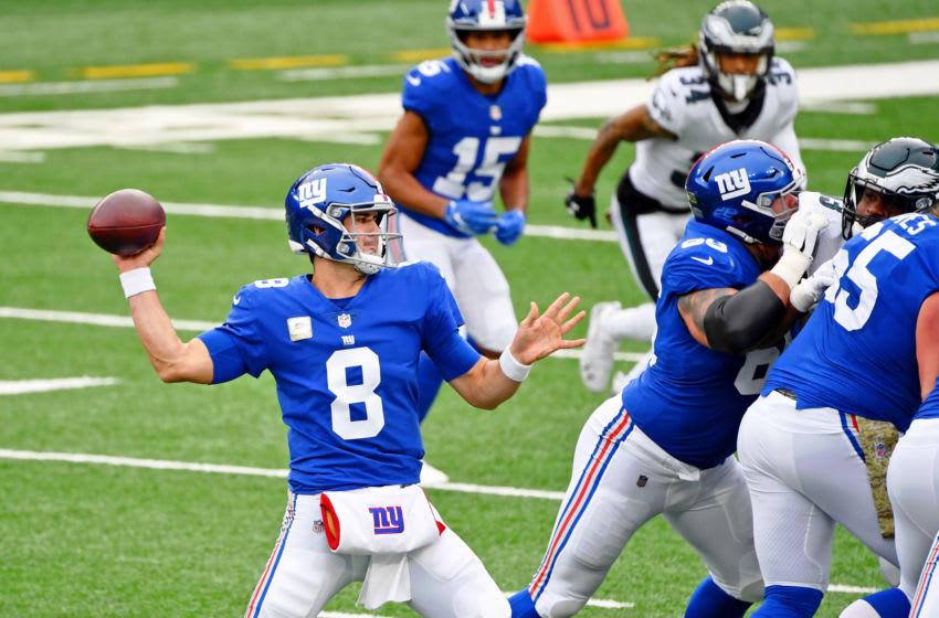 Nov 15, 2020; East Rutherford, New Jersey, USA; New York Giants quarterback Daniel Jones (8) throws against the Philadelphia Eagles during the first quarter at MetLife Stadium. Mandatory Credit: Robert Deutsch-USA TODAY Sports