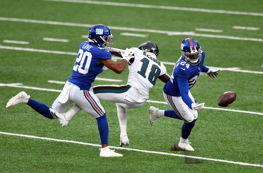 New York Giants cornerbacks Julian Love (20) and James Bradberry (24) break up a pass intended for Philadelphia Eagles wide receiver Jalen Reagor (18) in the first half at MetLife Stadium on Sunday, Nov. 15, 2020. Nyg Vs Phi