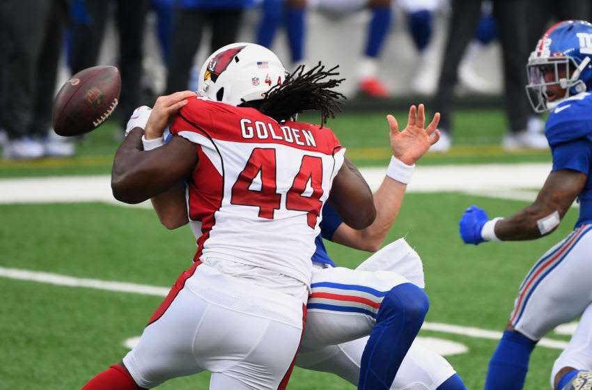 Dec 13, 2020; East Rutherford, New Jersey, USA; Arizona Cardinals linebacker Markus Golden (44) sacks New York Giants quarterback Daniel Jones (8) causing a fumble during the first half at MetLife Stadium. The Cardinals recovered the ball on the play. Mandatory Credit: Robert Deutsch-USA TODAY Sports
