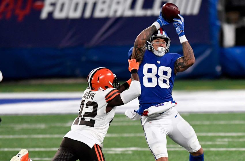 New York Giants tight end Evan Engram (88) makes a catch over Cleveland Browns safety Karl Joseph (42) in the second half. The Giants lose to the Browns, 20-6, at MetLife Stadium on Sunday, December 20, 2020, in East Rutherford. Nyg Vs Cle