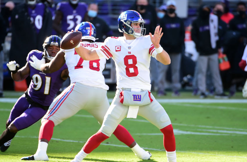 Dec 27, 2020; Baltimore, Maryland, USA; New York Giants quarterback Daniel Jones (8) throws a pass against the Baltimore Ravens in the first quarter at M&T Bank Stadium. Mandatory Credit: Evan Habeeb-USA TODAY Sports