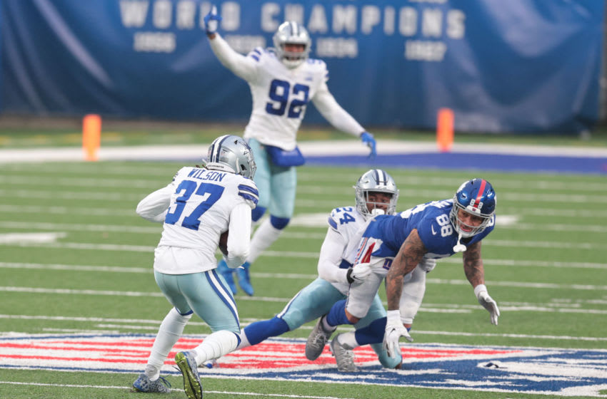 Dallas Cowboys safety Donovan Wilson (37) intercepts a pass intended for New York Giants tight end Evan Engram (88) in the second half at MetLife Stadium. Mandatory Credit: Vincent Carchietta-USA TODAY Sports