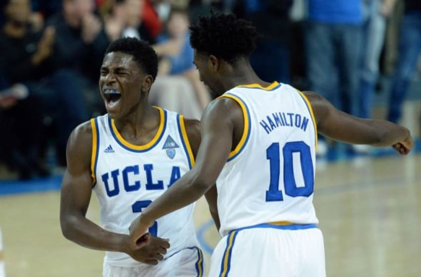 Jan 9, 2016; Los Angeles, CA, USA; UCLA Bruins guard Aaron Holiday (3) reacts with guard Isaac Hamilton (10) after making a three pointer during the second half against the Arizona State Sun Devils at Pauley Pavilion. Mandatory Credit: Jake Roth-USA TODAY Sports