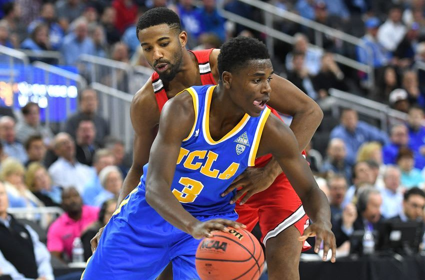 Dec 17, 2016; Las Vegas, NV, USA; UCLA Bruins guard Aaron Holiday (3) dribbles the ball around Ohio State Buckeyes guard JaQuan Lyle (13) during a game at T-Mobile Arena. UCLA won the game 86-73. Mandatory Credit: Stephen R. Sylvanie-USA TODAY Sports