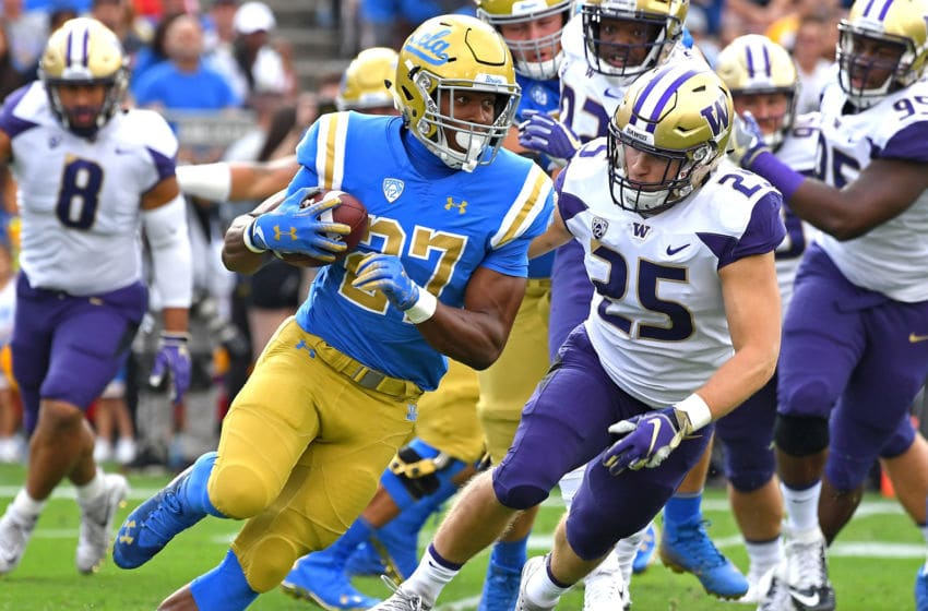 PASADENA, CA - OCTOBER 06: Linebacker Ben Burr-Kirven #25 of the Washington Huskies chases down running back Joshua Kelley #27 of the UCLA Bruins as he runs for a first down in the first quarter of the game at the Rose Bowl on October 6, 2018 in Pasadena, California. (Photo by Jayne Kamin-Oncea/Getty Images)