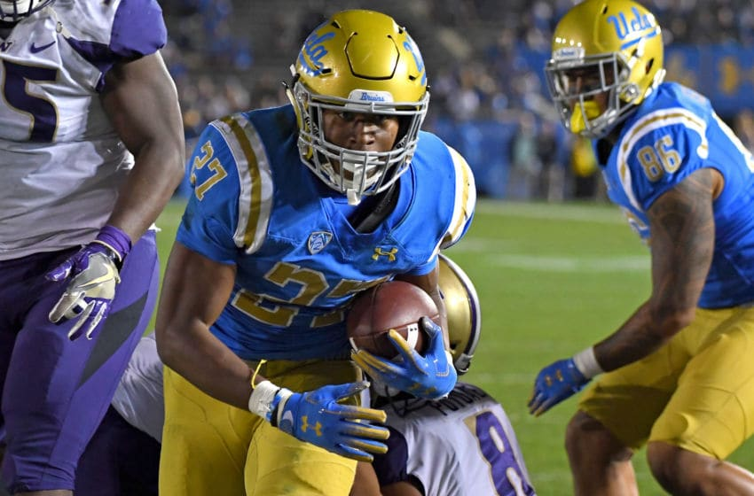 PASADENA, CA - OCTOBER 06: Running back Joshua Kelley #27 of the UCLA Bruins runs into the end zone for a touchdown in the fourth quarter of the game against the Washington Huskies at the Rose Bowl on October 6, 2018 in Pasadena, California. (Photo by Jayne Kamin-Oncea/Getty Images)
