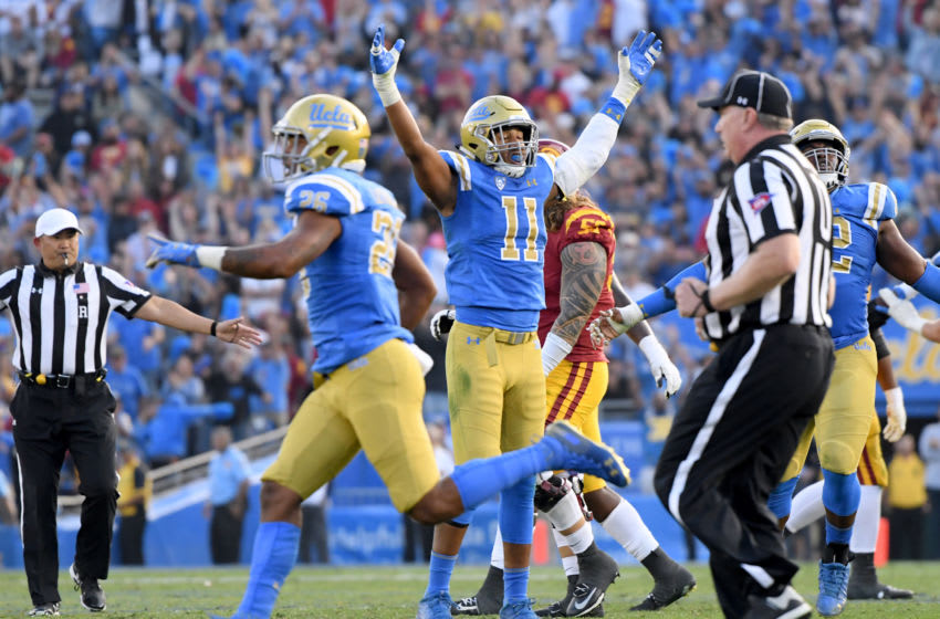 PASADENA, CALIFORNIA - NOVEMBER 17: Keisean Lucier-South #11 of the UCLA Bruins reacts after a stop of USC Trojans on fourth down sealing a 34-27 UCLA win at Rose Bowl on November 17, 2018 in Pasadena, California. (Photo by Harry How/Getty Images)