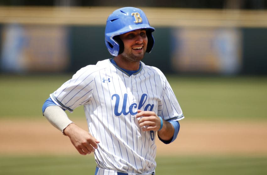 LOS ANGELES, CALIFORNIA - MAY 19: Jack Stronach #6 of UCLA smiles as he heads for home plate during a baseball game against University of Washington at Jackie Robinson Stadium on May 19, 2019 in Los Angeles, California. (Photo by Katharine Lotze/Getty Images)