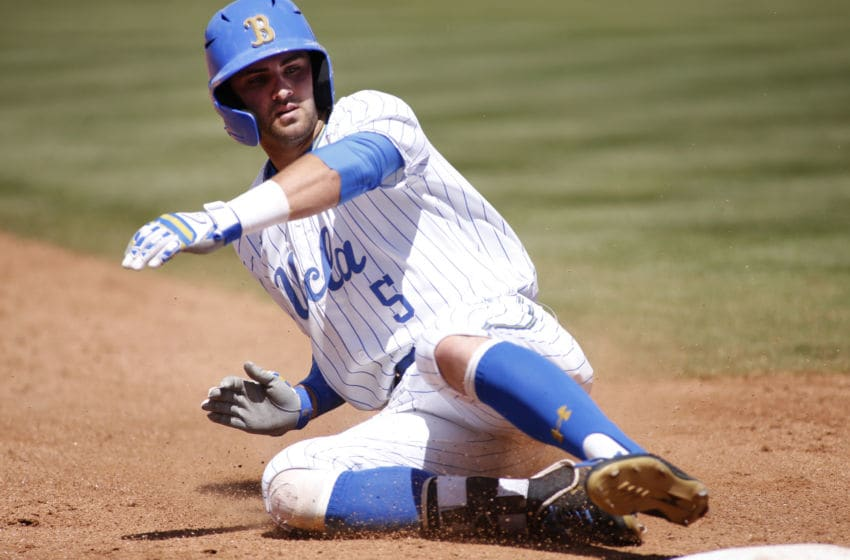 LOS ANGELES, CALIFORNIA - MAY 19: Garrett Mitchell #5 of UCLA slides into third base during a baseball game against University of Washington at Jackie Robinson Stadium on May 19, 2019 in Los Angeles, California. (Photo by Katharine Lotze/Getty Images)
