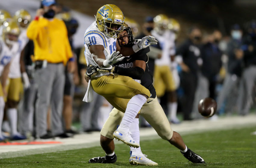 BOULDER, COLORADO - NOVEMBER 07: Isaiah Lewis #23 of the Colorado Buffaloes breaks up a pass to Demetric Felton #10 of the UCLA Bruins in the first quarter at Folsom Field on November 07, 2020 in Boulder, Colorado. (Photo by Matthew Stockman/Getty Images)