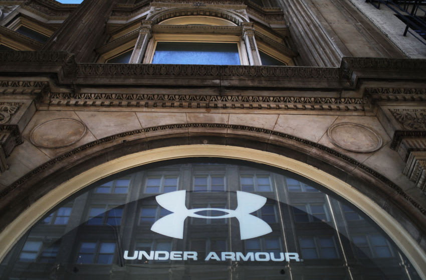 NEW YORK, NY - FEBRUARY 15: People walk by an Under Armour store in Manhattan on February 15, 2017 in New York City. Under Armour CEO and founder Kevin Plank has been trying to stem the negative publicity his company has been receiving since he publicly praised President Donald Trump. In an interview with CNBC Plank called the president a 'real asset for the country' due to his pro-business stance. (Photo by Spencer Platt/Getty Images)