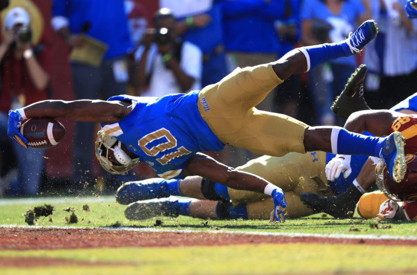 LOS ANGELES, CALIFORNIA - NOVEMBER 23: Demetric Felton #10 of the UCLA Bruins dives in for a touchdown during the first half of a game against the USC Trojans at Los Angeles Memorial Coliseum on November 23, 2019 in Los Angeles, California. (Photo by Sean M. Haffey/Getty Images)