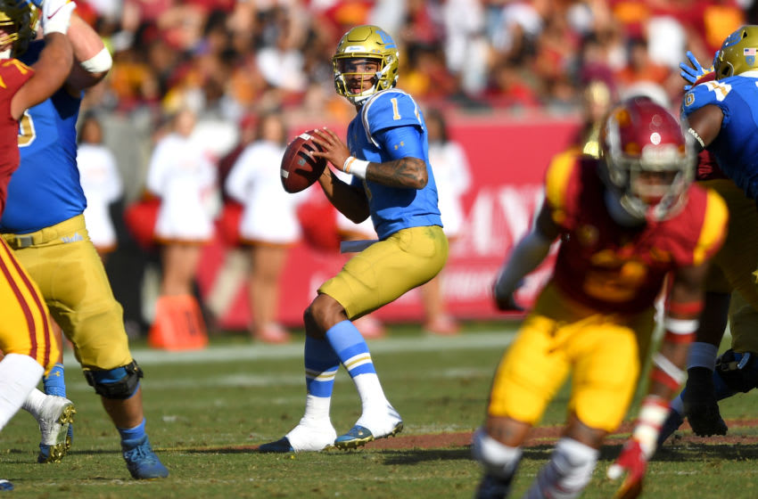 LOS ANGELES, CA - NOVEMBER 23: Quarterback Dorian Thompson-Robinson #1 of the UCLA Bruins sets to pass the ball in the first half of the game against the USC Trojans at the Los Angeles Memorial Coliseum on November 23, 2019 in Los Angeles, California. (Photo by Jayne Kamin-Oncea/Getty Images)