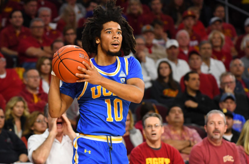 LOS ANGELES, CA - MARCH 07: Tyger Campbell #10 of the UCLA Bruins looks to pass the ball during the game against the USC Trojans at Galen Center on March 7, 2020 in Los Angeles, California. (Photo by Jayne Kamin-Oncea/Getty Images)