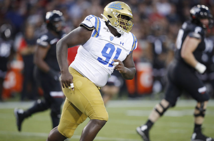 CINCINNATI, OH - AUGUST 29: Otito Ogbonnia #91 of the UCLA Bruins in action on defense during a game against the Cincinnati Bearcats at Nippert Stadium on August 29, 2019 in Cincinnati, Ohio. Cincinnati defeated UCLA 24-14. (Photo by Joe Robbins/Getty Images)