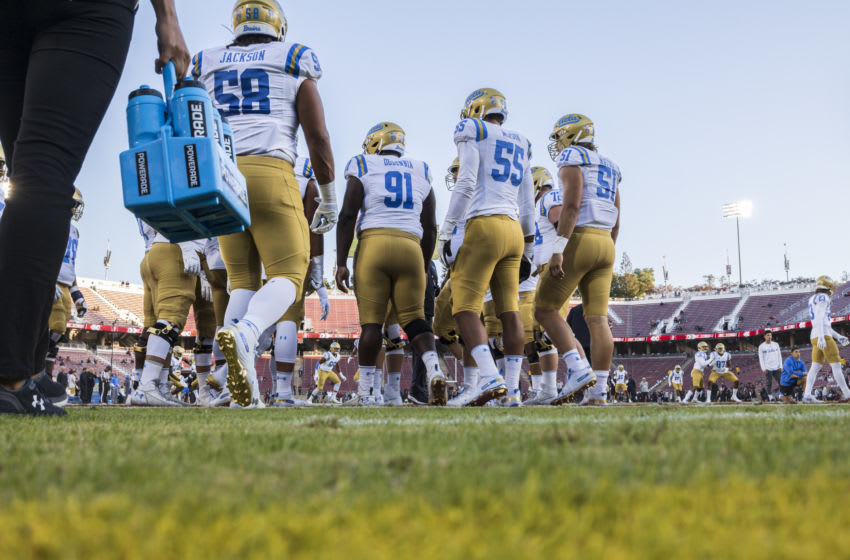 PALO ALTO, CA - OCTOBER 17: Members of the UCLA Bruins football team warm up before an NCAA Pac-12 college football game against the Stanford Cardinal on October 17, 2019 at Stanford Stadium in Palo Alto, California. (Photo by David Madison/Getty Images)