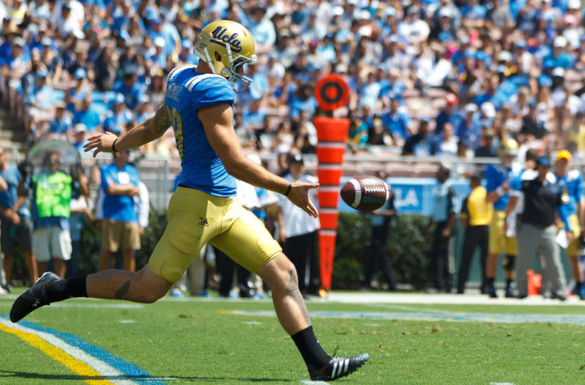 PASADENA, CA - SEPTEMBER 05: Punter Matt Mengel #19 of the UCLA Bruins punts against the Virginia Cavaliers during the first quarter at the Rose Bowl on September 5, 2015 in Pasadena, California. The UCLA Bruins defeated the Virginia Cavaliers 34-16. (Photo by Jason O. Watson/Getty Images)