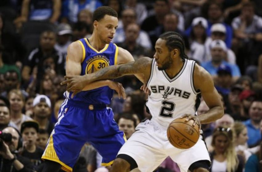 Apr 5, 2015; San Antonio, TX, USA; San Antonio Spurs small forward Kawhi Leonard (2) is defended by Golden State Warriors point guard Stephen Curry (30) during the second half at AT&T Center. Mandatory Credit: Soobum Im-USA TODAY Sports