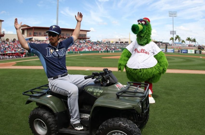 Mar 13, 2015; Clearwater, FL, USA; Philadelphia Phillies mascot Phanatic (right) and Tampa Bay Rays shortstop Hak-Ju Lee (36) entertain the crowd during a spring training baseball game between the Tampa Bay Rays and Philadelphia Phillies at Bright House Field. Mandatory Credit: Reinhold Matay-USA TODAY Sports