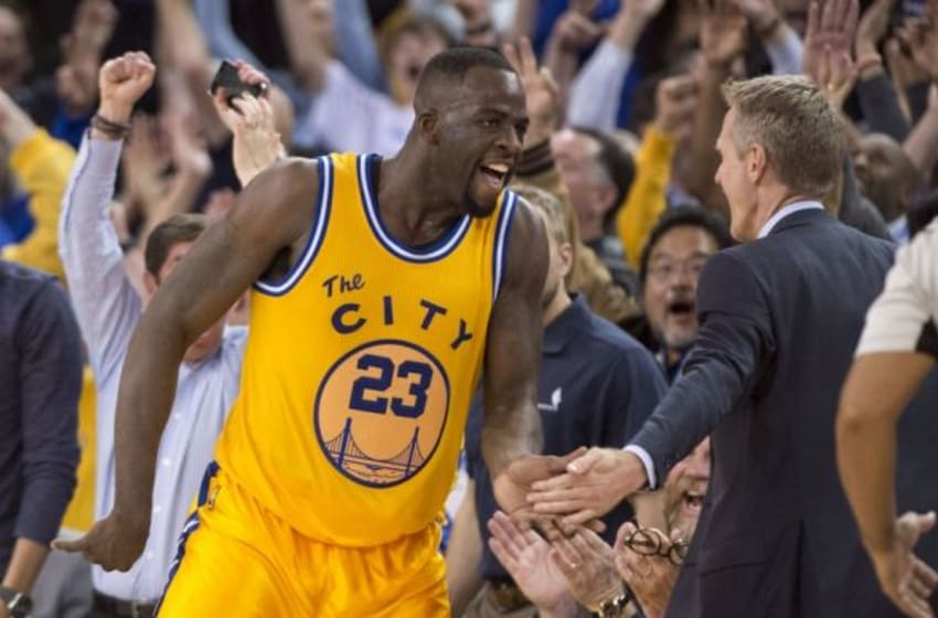March 1, 2016; Oakland, CA, USA; Golden State Warriors forward Draymond Green (23) is congratulated by head coach Steve Kerr (right) after making a three-point basket against the Atlanta Hawks during overtime at Oracle Arena. The Warriors defeated the Hawks 109-105 in overtime. Mandatory Credit: Kyle Terada-USA TODAY Sports
