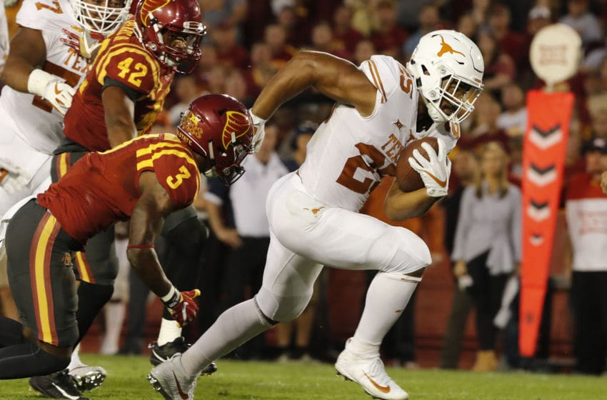 AMES, IA - SEPTEMBER 28: Running back Chris Warren III #25 of the Texas Longhorns drives the ball into the end zone as defensive back Reggie Wilkerson #3, and linebacker Marcel Spears Jr. #42 of the Iowa State Cyclones defend in the first half of play at Jack Trice Stadium on September 28, 2017 in Ames, Iowa. (Photo by David Purdy/Getty Images)