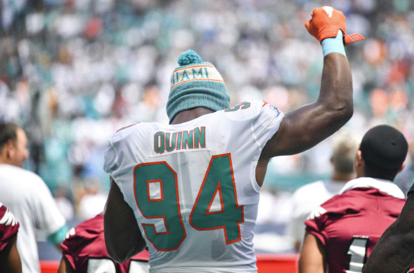 MIAMI, FL - SEPTEMBER 09: Robert Quinn #94 of the Miami Dolphins raises his fist during the National Anthem against the Tennessee Titans at Hard Rock Stadium on September 9, 2018 in Miami, Florida. (Photo by Mark Brown/Getty Images)