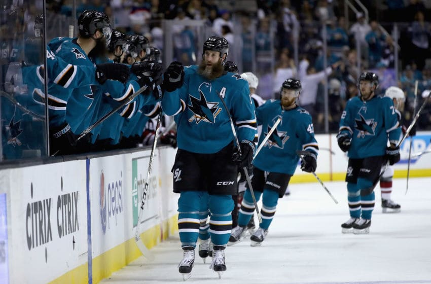 SAN JOSE, CA - JANUARY 13: Joe Thornton #19 of the San Jose Sharks is congratulated by teammates after scoing in the first period against the Arizona Coyotes at SAP Center on January 13, 2018 in San Jose, California. (Photo by Ezra Shaw/Getty Images)