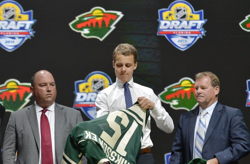 Jun 26, 2015; Sunrise, FL, USA; Joel Eriksson puts on his team jersey after being selected as the number twenty overall pick to the Minnesota Wild in the first round of the 2015 NHL Draft at BB&T Center. Mandatory Credit: Steve Mitchell-USA TODAY Sports