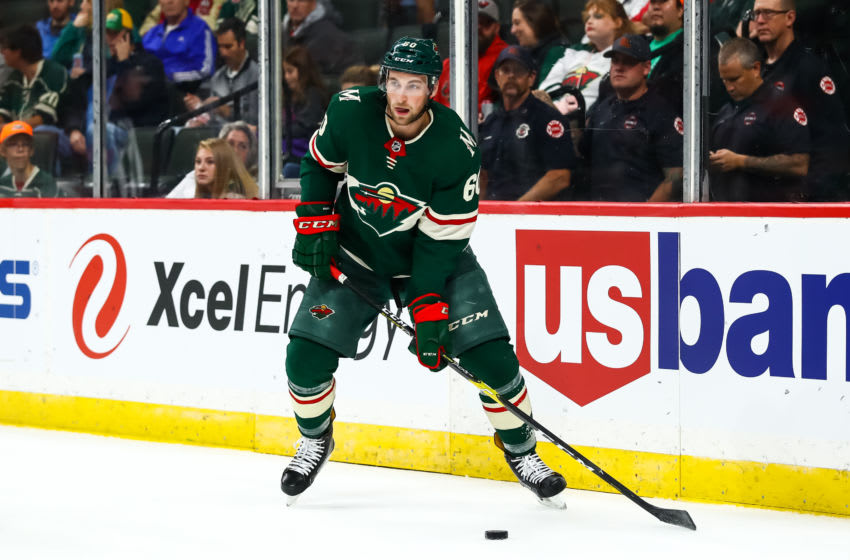 ST. PAUL, MN - SEPTEMBER 20: Minnesota Wild defenseman Carson Soucy (60) looks for a pass during the preseason game between the Dallas Stars and the Minnesota Wild on September 20, 2018 at Xcel Energy Center in St. Paul, Minnesota. (Photo by David Berding/Icon Sportswire via Getty Images)