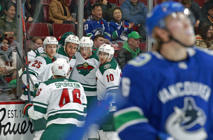 VANCOUVER, BC - OCTOBER 29: Jordan Greenway #18 of the Minnesota Wild is congratulated by teammate after scoring during their NHL game against the Vancouver Canucks at Rogers Arena October 29, 2018 in Vancouver, British Columbia, Canada. (Photo by Jeff Vinnick/NHLI via Getty Images)
