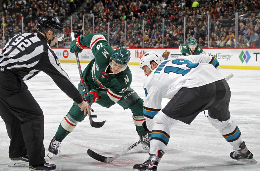 ST. PAUL, MN - DECEMBER 18: Joel Eriksson Ek #14 of the Minnesota Wild and Joe Thornton #19 of the San Jose Sharks face-off during a game at Xcel Energy Center on December 18, 2018 in St. Paul, Minnesota.(Photo by Bruce Kluckhohn/NHLI via Getty Images)