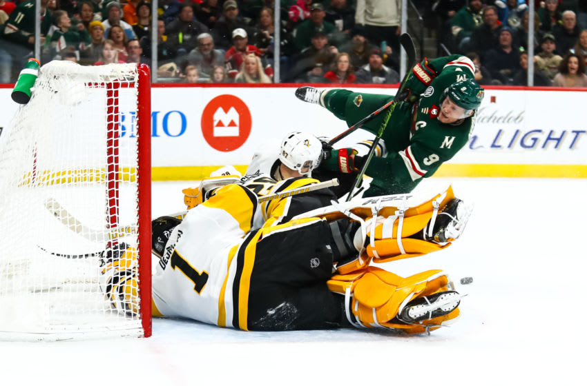 ST. PAUL, MN - DECEMBER 31: Casey DeSmith (1) of the Pittsburgh Penguins makes a save on Mikko Koivu (9) of the Minnesota Wild in the second period on December 31, 2018 at Xcel Energy Center in St. Paul, Minnesota. (Photo by David Berding/Icon Sportswire via Getty Images)