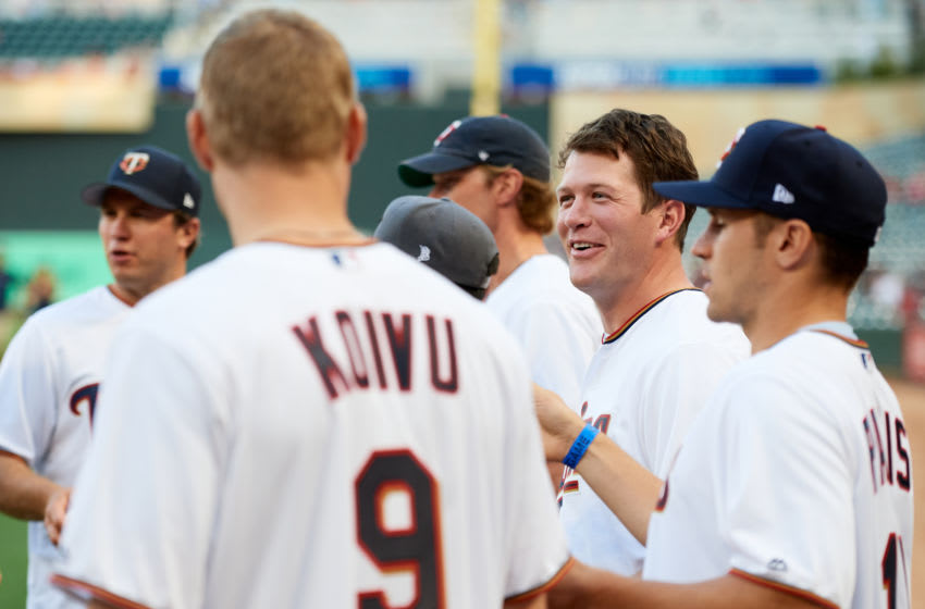 MINNEAPOLIS, MINNESOTA - SEPTEMBER 10: Ryan Suter #20 of the Minnesota Wild speaks to teammates before delivering a ceremonial pitch before the interleague game between the Minnesota Twins and the Washington Nationals at Target Field on September 10, 2019 in Minneapolis, Minnesota. The Twins defeated the Nationals 5-0. (Photo by Hannah Foslien/Getty Images)
