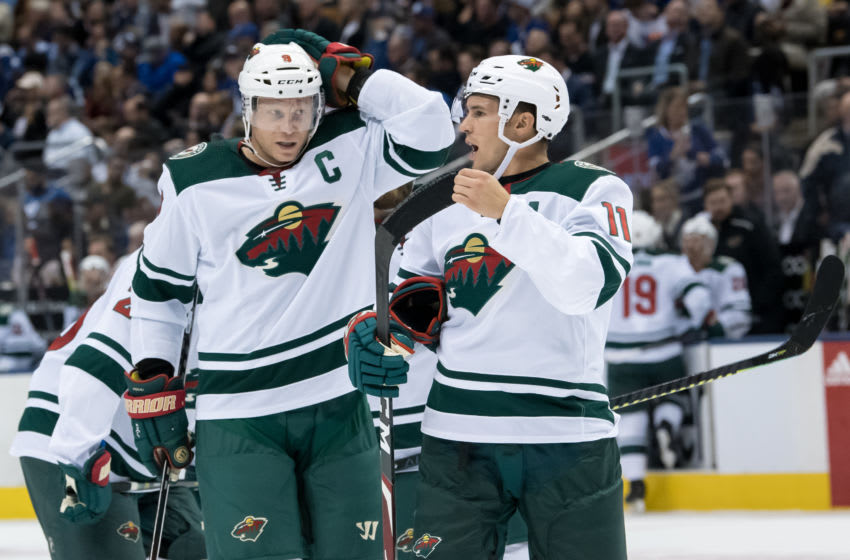 TORONTO, ON - OCTOBER 15: Minnesota Wild Left Wing Zach Parise (11) and Minnesota Wild Center Mikko Koivu (9) talk during the NHL regular season game between the Minnesota Wild and the Toronto Maple Leafs on October 15, 2019, at Scotiabank Arena in Toronto, ON, Canada. (Photo by Julian Avram/Icon Sportswire via Getty Images)