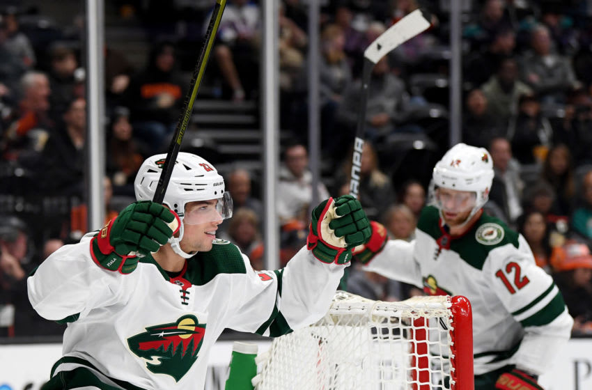 ANAHEIM, CALIFORNIA - NOVEMBER 05: Kevin Fiala #22 of the Minnesota Wild celebrates his goal with Eric Staal #12, to trail 2-1 to the Anaheim Ducks, during the second period at Honda Center on November 05, 2019 in Anaheim, California. (Photo by Harry How/Getty Images)