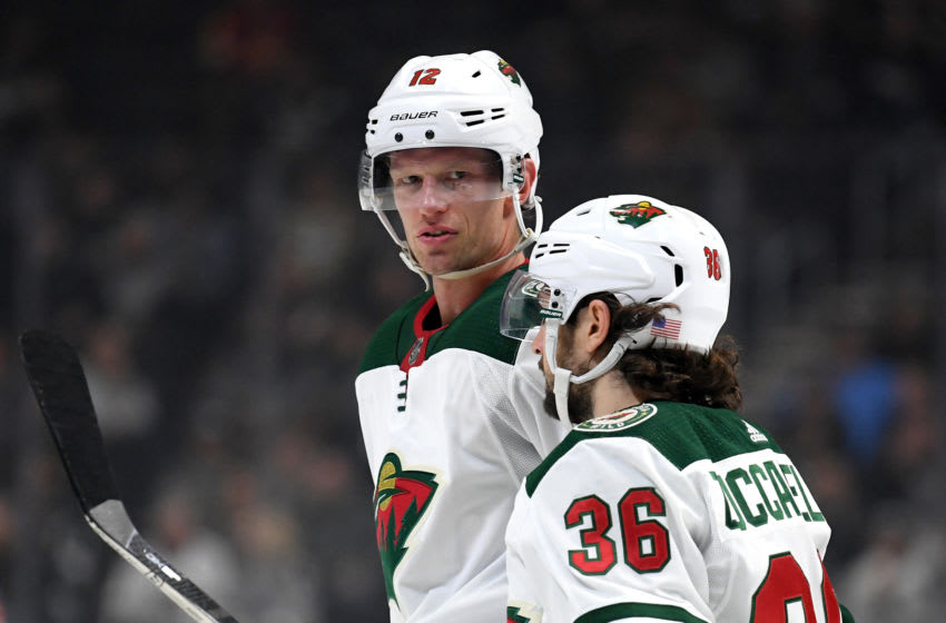 LOS ANGELES, CALIFORNIA - NOVEMBER 12: Eric Staal #12 of the Minnesota Wild speaks with Mats Zuccarello #36 during a 3-1 loss to the Los Angeles Kings at Staples Center on November 12, 2019 in Los Angeles, California. (Photo by Harry How/Getty Images)