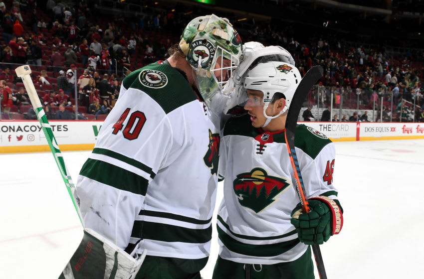 GLENDALE, ARIZONA - DECEMBER 19: Goalie Devan Dubnyk #40 of the Minnesota Wild is congratulated by teammate Victor Rask #49 following an 8-5 victory against the Arizona Coyotes during the NHL hockey game at Gila River Arena on December 19, 2019 in Glendale, Arizona. (Photo by Norm Hall/NHLI via Getty Images)