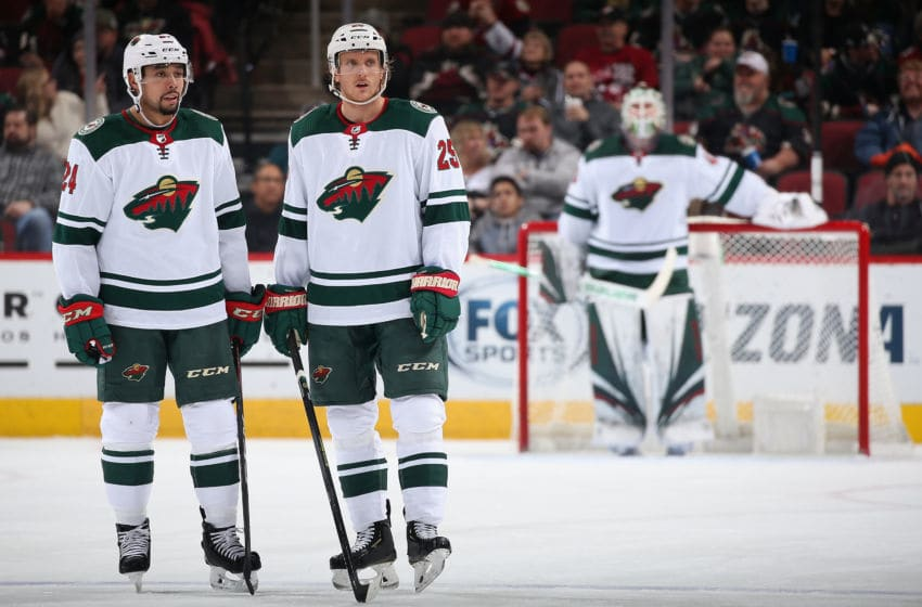 GLENDALE, ARIZONA - DECEMBER 19: Matt Dumba #24 and Jonas Brodin #25 of the Minnesota Wild during the third period of the NHL game against the Arizona Coyotes at Gila River Arena on December 19, 2019 in Glendale, Arizona. The Wild defeated the Coyotes 8-5. (Photo by Christian Petersen/Getty Images)