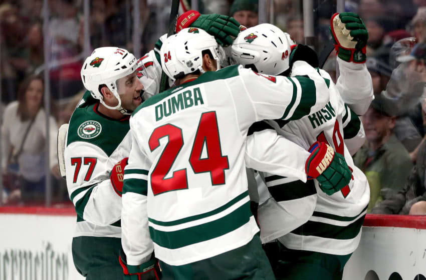 DENVER, COLORADO - DECEMBER 27: Victor Rask #49 of the Minnesota Wild is congratulated by Brad Hunt #77 and Matt Dumba #24 after scoring the go ahead goal against the Colorado Avalanche in the third period at the Pepsi Center on December 27, 2019 in Denver, Colorado. (Photo by Matthew Stockman/Getty Images)