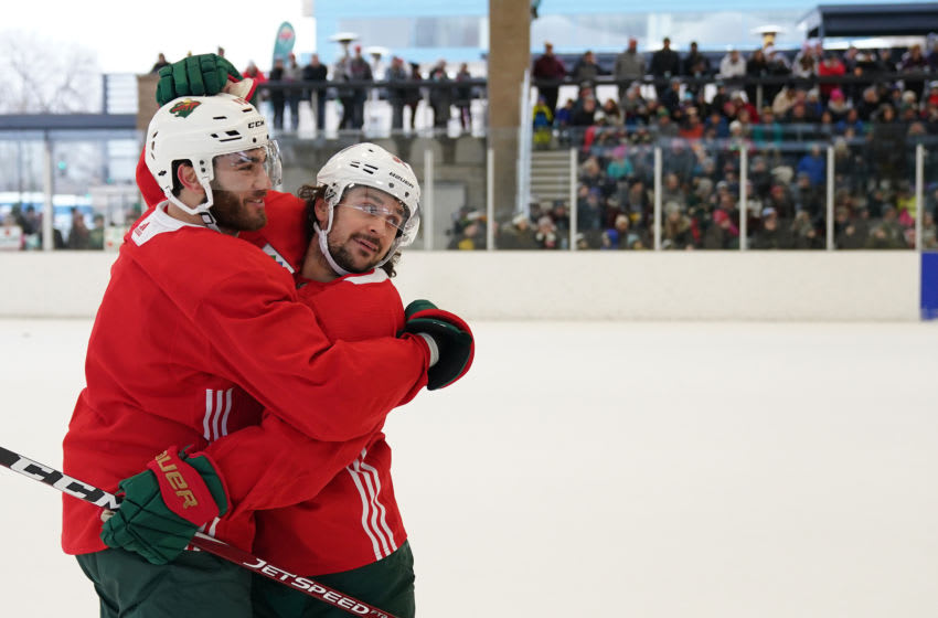St. Louis Park, MN January 2: Minnesota Wild right wing Mats Zuccarello (36) celebrated with center Luke Kunin (19) after they scored on goaltender Devan Dubnyk (40) during the Wild's outdoor practice Thursday. (Photo by Anthony Souffle/Star Tribune via Getty Images)